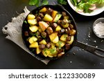 cooked fried potatoes with... | Shutterstock . vector #1122330089