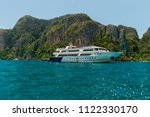 motor boat and island in the sea | Shutterstock . vector #1122330170