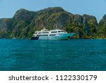 motor boat and island in the sea | Shutterstock . vector #1122330179
