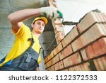 bricklaying. construction... | Shutterstock . vector #1122372533