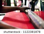 an elderly thai woman weaves... | Shutterstock . vector #1122381878