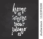 home is where your piano is  ... | Shutterstock .eps vector #1122393200