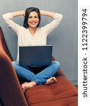 happy young woman at home...   Shutterstock . vector #1122399794