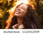 portrait closeup of happy curly ... | Shutterstock . vector #1122412559