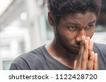 thoughtful african man thinking ... | Shutterstock . vector #1122428720