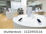 showcase with smartphones in a... | Shutterstock . vector #1122453116