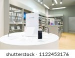smartphones on a showcase in a... | Shutterstock . vector #1122453176