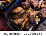 delicious baked pork with herbs ... | Shutterstock . vector #1122456956