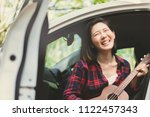 cheerful hipster girl playing... | Shutterstock . vector #1122457343