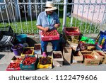 people sell their crops on the... | Shutterstock . vector #1122479606