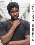 sick african man with sore...   Shutterstock . vector #1122487460