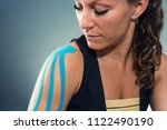 female with kinesiotape on... | Shutterstock . vector #1122490190