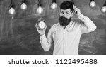 teacher in eyeglasses holds... | Shutterstock . vector #1122495488
