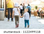 boy holding sister's hand and... | Shutterstock . vector #1122499118