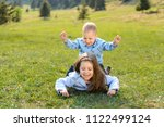 happy brother and sister laying ... | Shutterstock . vector #1122499124