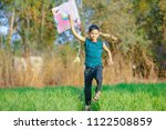 indian child playing with kite | Shutterstock . vector #1122508859