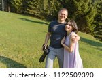 smiling man with camera hugging ... | Shutterstock . vector #1122509390