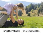 father laying on grass and... | Shutterstock . vector #1122509888