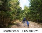 tourist holding camera in one... | Shutterstock . vector #1122509894