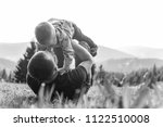father holding son in arms and... | Shutterstock . vector #1122510008