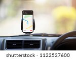 mobile phone with map gps... | Shutterstock . vector #1122527600