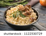 frying pan with risotto and...   Shutterstock . vector #1122530729