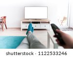 man watching smart tv blank... | Shutterstock . vector #1122533246
