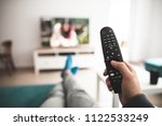 man watching smart tv... | Shutterstock . vector #1122533249