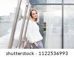 young pretty female employee... | Shutterstock . vector #1122536993
