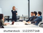 group of coworkers during a... | Shutterstock . vector #1122557168