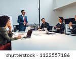 group of coworkers during a... | Shutterstock . vector #1122557186