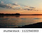 the evening sky over the river | Shutterstock . vector #1122560303