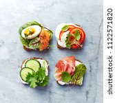 healthy open sandwiches with... | Shutterstock . vector #1122571820