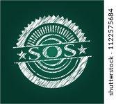 sos chalk emblem written on a... | Shutterstock .eps vector #1122575684