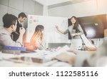 businesswoman presenting to... | Shutterstock . vector #1122585116