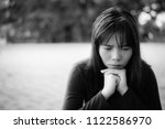 asian woman sitting alone and... | Shutterstock . vector #1122586970