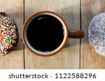black coffee and donuts on... | Shutterstock . vector #1122588296