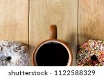 black coffee and donuts on... | Shutterstock . vector #1122588329