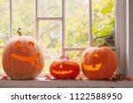 halloween pumpkin on window | Shutterstock . vector #1122588950