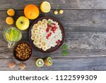 oatmeal and fruit on old... | Shutterstock . vector #1122599309