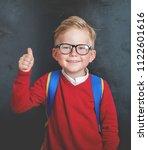 back to school. happy little... | Shutterstock . vector #1122601616