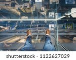 Small photo of Chicago, Illinois, USA - June 2016: Looking down from the glass box ledge of the Willis Tower skydeck, with downtown Chicago visible beneath the glass floor