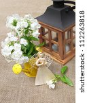 Composition from the bouquet of white phloxes  lantern and straw angel - stock photo