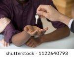 realtor giving keys to new... | Shutterstock . vector #1122640793