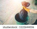 women volunteer help garbage... | Shutterstock . vector #1122644036