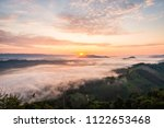 sunrise and the mist in winter...   Shutterstock . vector #1122653468