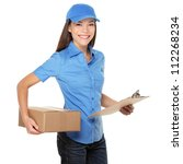 Delivery person delivering packages holding clipboard and package smiling happy in blue uniform. Beautiful young mixed race Caucasian / Asian woman professional courier isolated on white background - stock photo