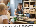 two young girls doing woodwork... | Shutterstock . vector #1122686876
