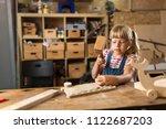girl building birdhouse in... | Shutterstock . vector #1122687203