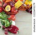 frame of fresh vegetables on a... | Shutterstock . vector #1122693179